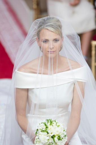 princess charlene of monaco with face veil seated during her wedding to prince albert