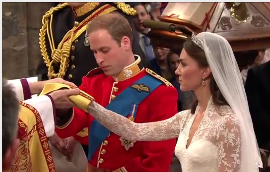 Archbishop of Canterbury wraps hands of William and Kate